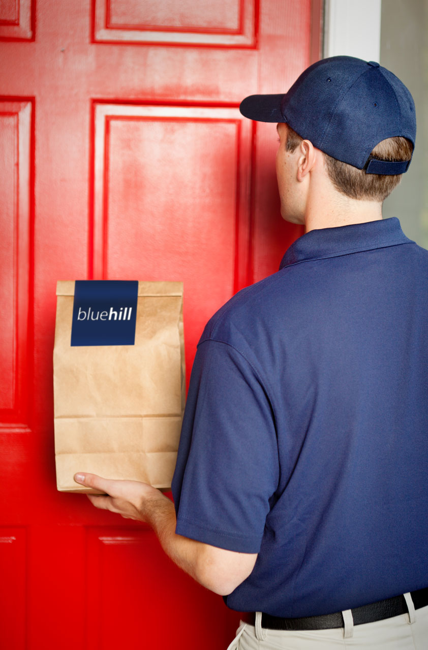 A delivery person bringing a tasty dinner to your home, prepared by Blue Hill Tavern in Brewer's Hill, Baltimore, MD
